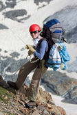 Climber girl going down on rope — Stock Photo