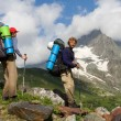 Stock Photo: Couple of mountain-climbers