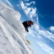 Stock Photo: Skier rush in clouds of snow powder