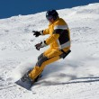 Snowboard in yellow suite - Stock Photo
