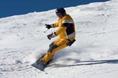 Snowboard in yellow suite — Stock Photo