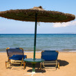 Sunshade and two beach bed — Stock Photo
