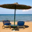 Stock Photo: Sunshade and two beach bed