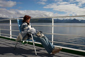 Girl sitting on the cruise liner deck — Stok fotoğraf