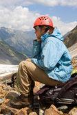 Mountaineer girl in helmet — Stock Photo