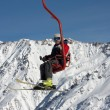 Skier on ski lift — Stock Photo
