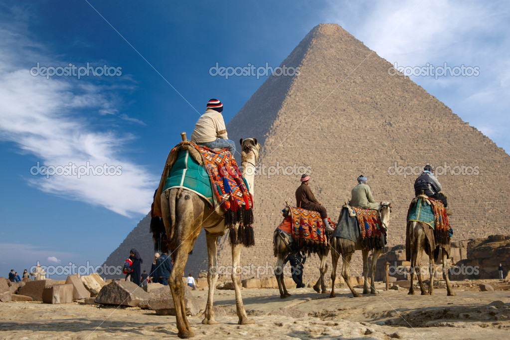 Bedouins on camel near of great pyramid in egypt  Stock Photo #1589729