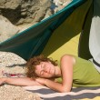 Girl sleeping near of tent — Stock Photo