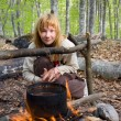Stock Photo: Girl sitting near of bonfire in forest