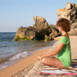 Yoga practise on the beach — Stock Photo