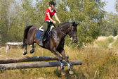 Woman on jumping horse — Stock Photo