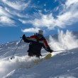 Skier tearing at full speed - Stock Photo