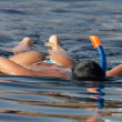 Stock Photo: Swimming girl with snorkel