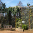 Birdcage with plant in a zoo — Stok fotoğraf
