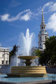 Fountain on Trafalgar Square in London — Stock Photo