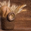 Basket with grain bread and cereals. — Stock Photo