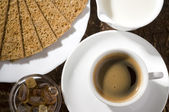 Black coffee cup with crackers — Stock Photo