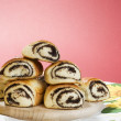 Baked bun with poppy seeds - Stock Photo
