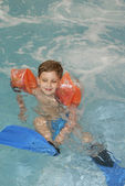 Little boy with flippers — Stock Photo