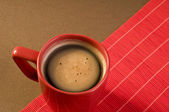 Black coffee drink in a red cup — Stock Photo