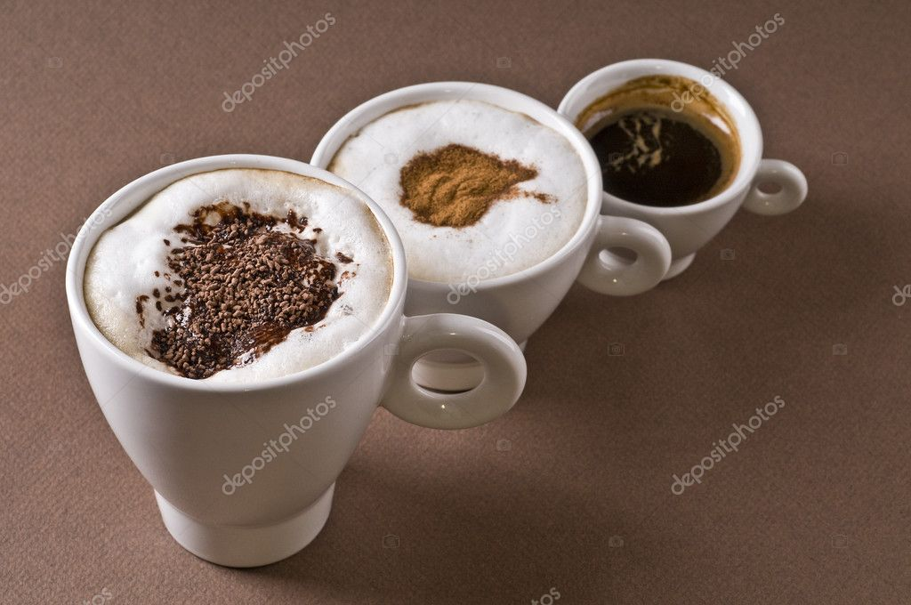 Three coffee cups with espresso, cappuccino, mochaccino over brown background — Lizenzfreies Foto #1643172