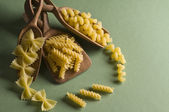 Dried pasta in wood spoon — Stock Photo