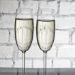 Two wineglasses of champagne - Stock Photo