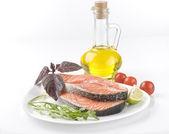 Raw salmon steak with herbs, vegetables — Stock Photo