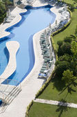 Luxury hotels with curve beautiful water pool — Stock Photo
