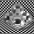 Glass balls on checkerboard background — Stock Photo