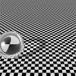 Royalty-Free Stock Photo: Clear glass ball on checkerboard