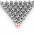 Soccer balls group with leader — Stock Photo