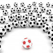 Royalty-Free Stock Photo: Soccer balls around team leader