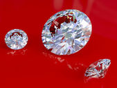 Big and small diamonds on red — Stock Photo
