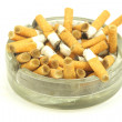 Cigarette butt in a ashtray - Stock Photo