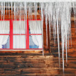 Icicles on wooden house — Stock Photo #1484666