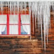 Royalty-Free Stock Photo: Icicles on wooden house