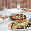 Greek salad and stuffed fish — Stock Photo