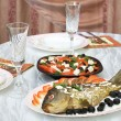 Greek salad and stuffed fish — Stock Photo #1565825