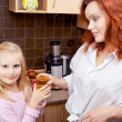 Mother standing in the kitchen — Stock Photo