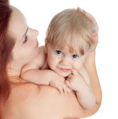 Cute baby girl in a hug mother — Stock Photo
