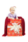 Smiling baby girl in gift box — Stock Photo