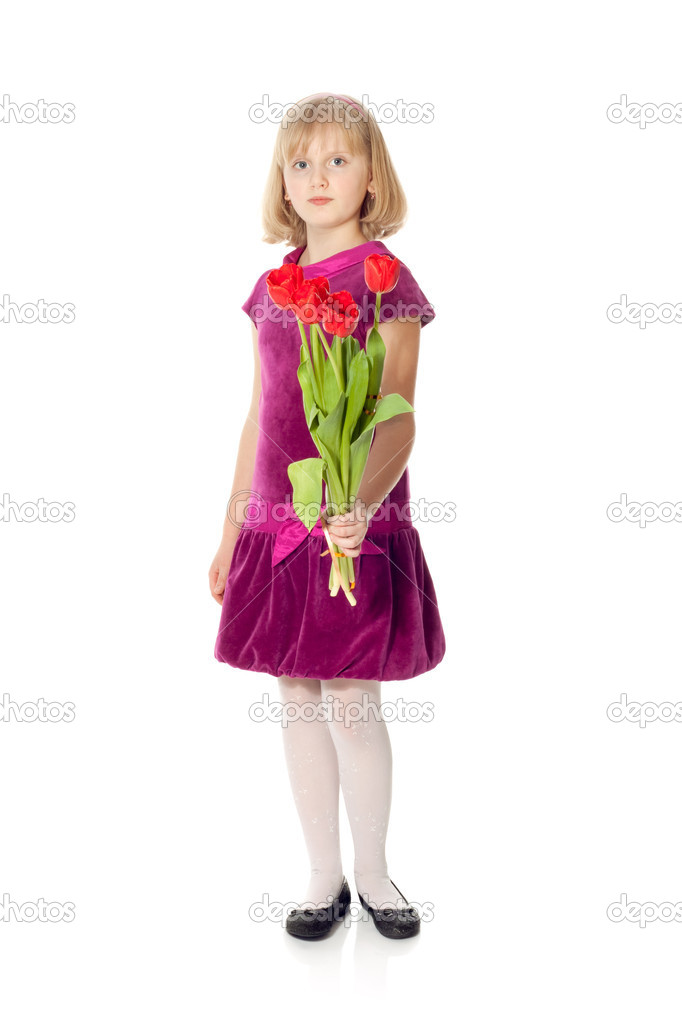Cute girl giving a bouquet of tulips isolated on white  Stock Photo #2407930
