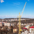 Hoisting crane in the city center — Stock Photo