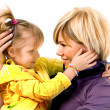 Little girl hugging a mother — Stock Photo
