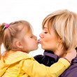 Royalty-Free Stock Photo: Young mother and little daughter is kissed