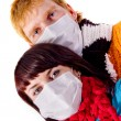 Young couple in medical masks — Stock Photo