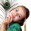 Royalty-Free Stock Photo: Girl with the feather  of peacock