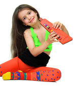 A girl with musical instrument — Stock Photo