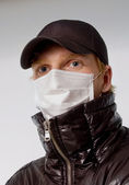 Young man in a medical mask flu — Stock Photo